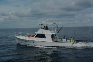 Rip Tide Deep Sea Fishing Boat on Water
